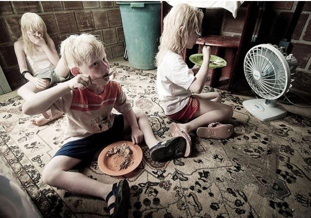 Família negra filhos albinos